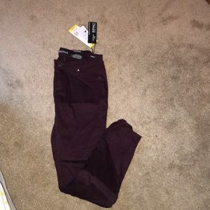 Maroon skinny jeans. New with tags.